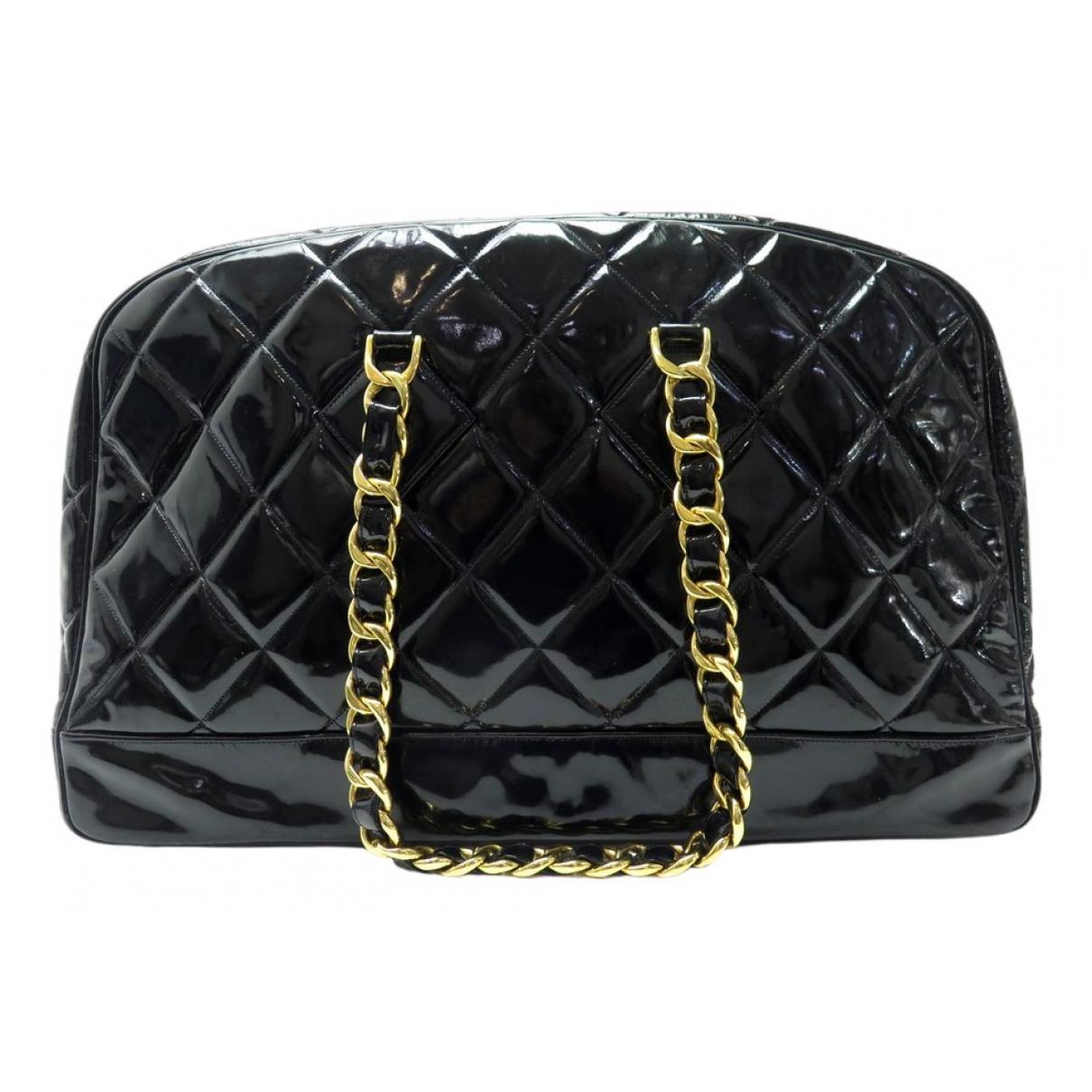 Chanel - Sac de voyage   pour femme en cuir verni - noir