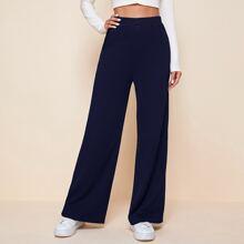 Pantalones palazzo unicolor de cintura elastica