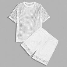 Maenner Top mit sehr tief angesetzter Schulterpartie, Netzstoff & Shorts Set