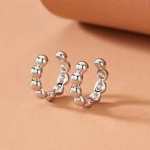 2 Stuecke Ohrringe mit rundem Design
