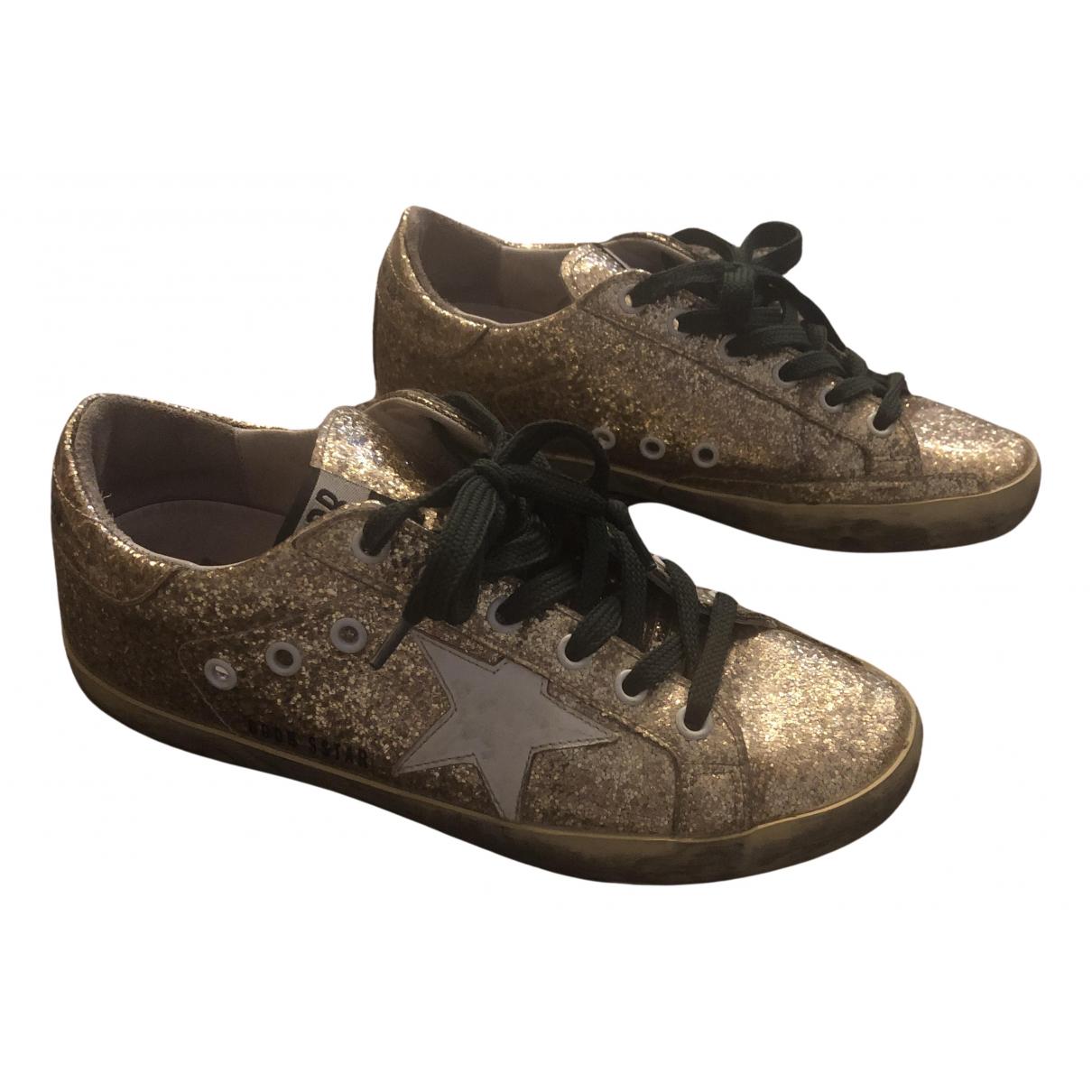 Golden Goose Superstar Sneakers in  Gold Leder