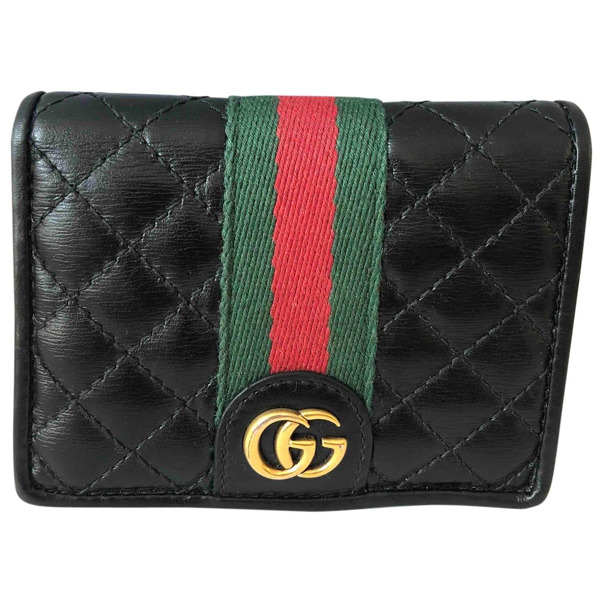 Gucci \N Portemonnaie in  Schwarz Leder