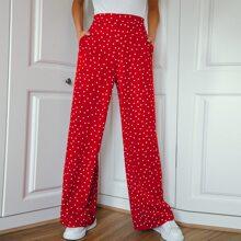 Hose mit schraegen Taschen, breitem Beinschnitt und Punkten Muster
