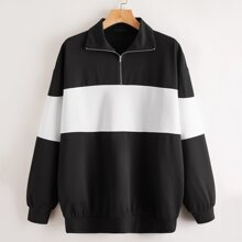 Zweifarbiges langes Sweatshirt mit halber Reissverschlussleiste und sehr tief angesetzter Schulterpartie