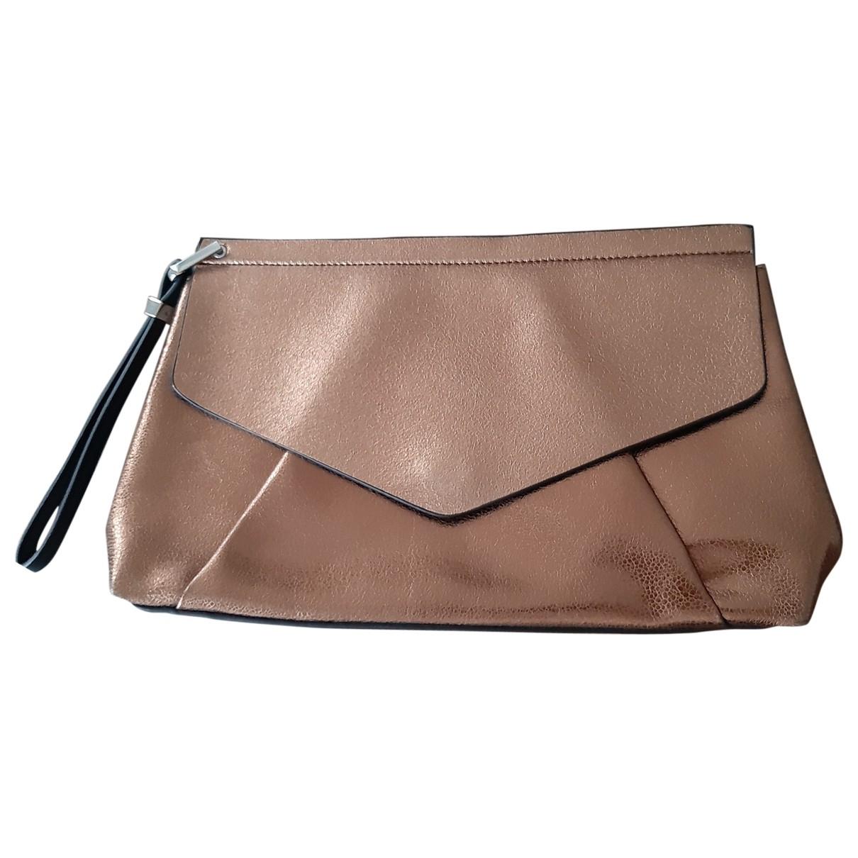 Bolsos clutch en Plastico Dorado Zara