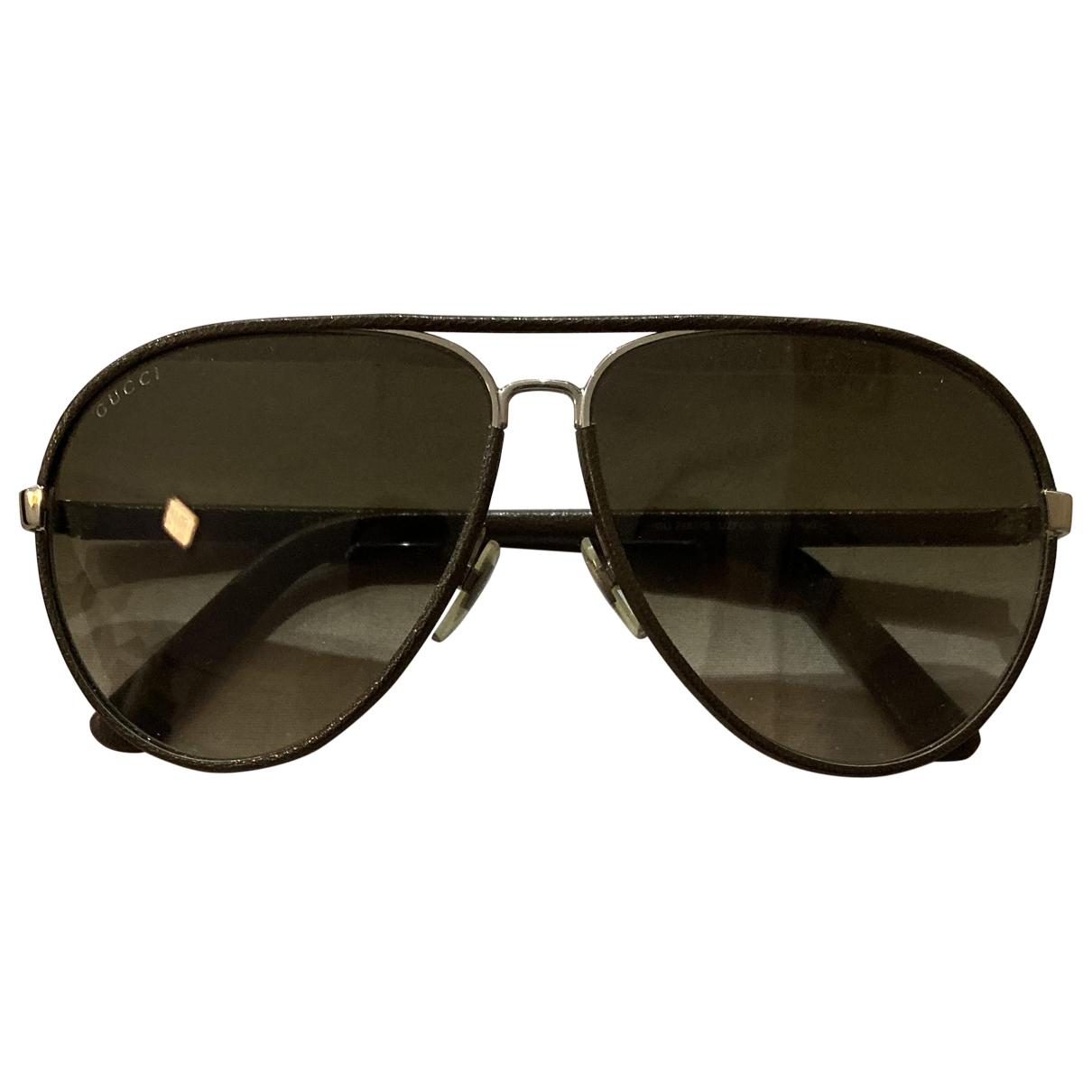 Gucci \N Sonnenbrillen in  Braun Leder