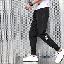 Pantalones deportivos de hombres de cintura con cordon de rayas