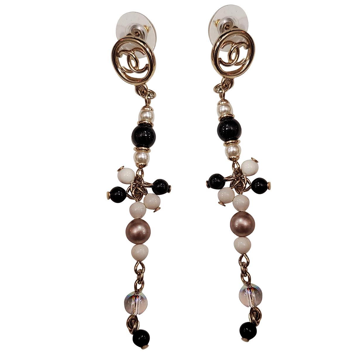 Chanel - Boucles doreilles   pour femme en acier - dore