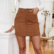 Falda mini de pana con boton