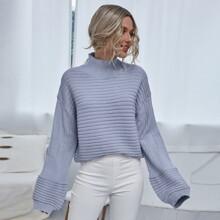 Jersey tejido de canale de hombros caidos de cuello alto