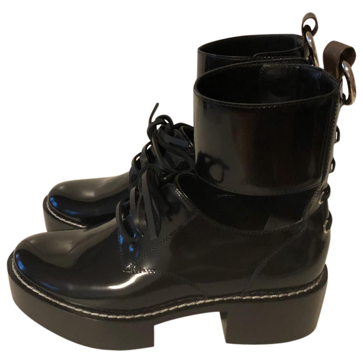 Louis Vuitton \N Stiefeletten in  Schwarz Lackleder
