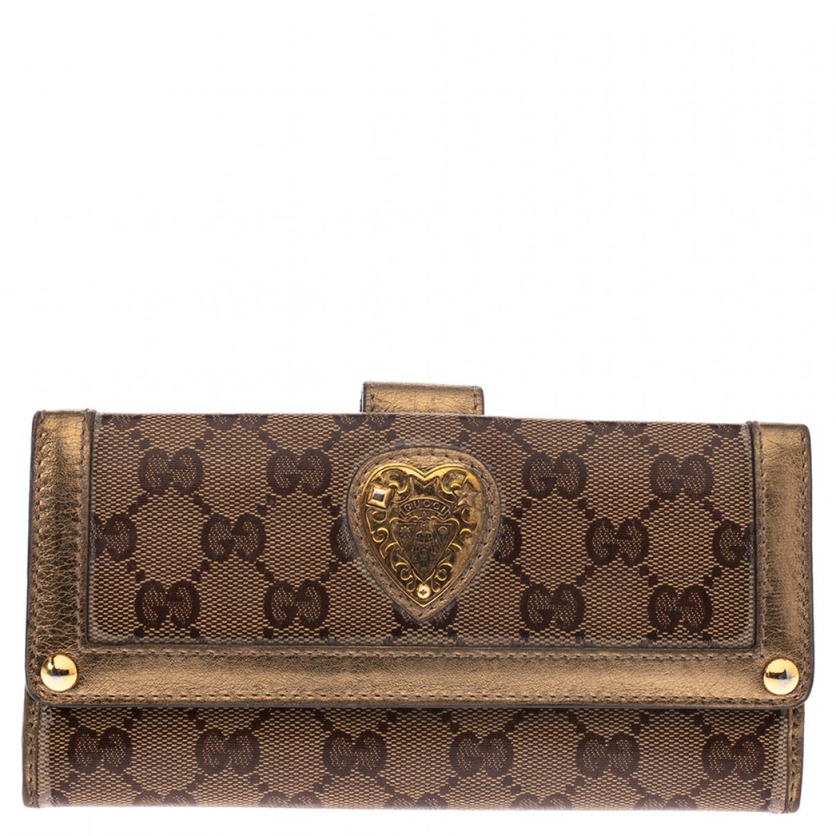 Gucci \N Portemonnaie in  Braun Leder