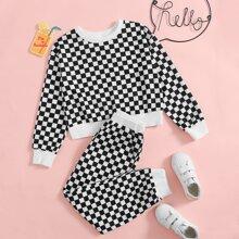 Pullover mit sehr tief angesetzter Schulterpartie und Karo Muster & Hose Set