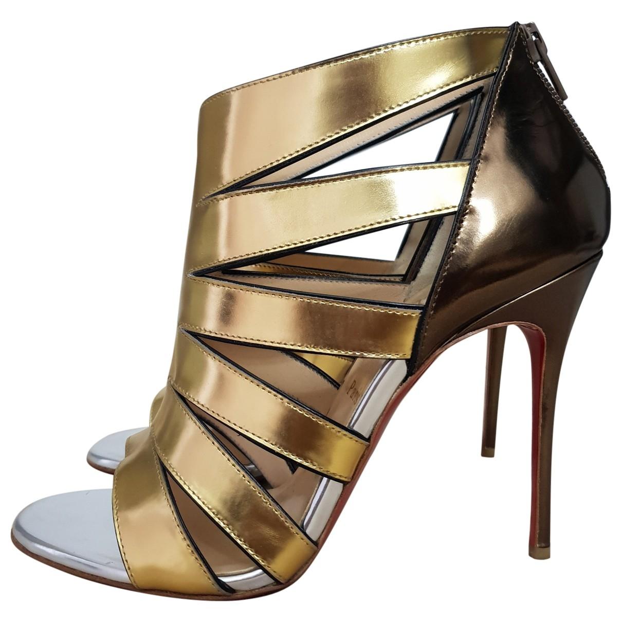 Christian Louboutin \N Stiefeletten in  Gold Leder