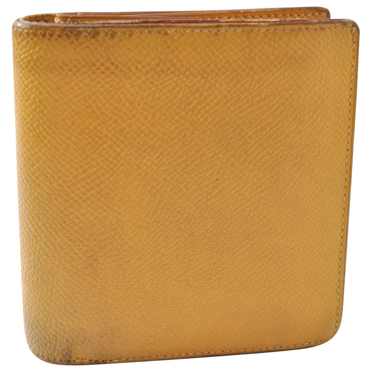 Hermes - Portefeuille   pour femme en cuir - jaune