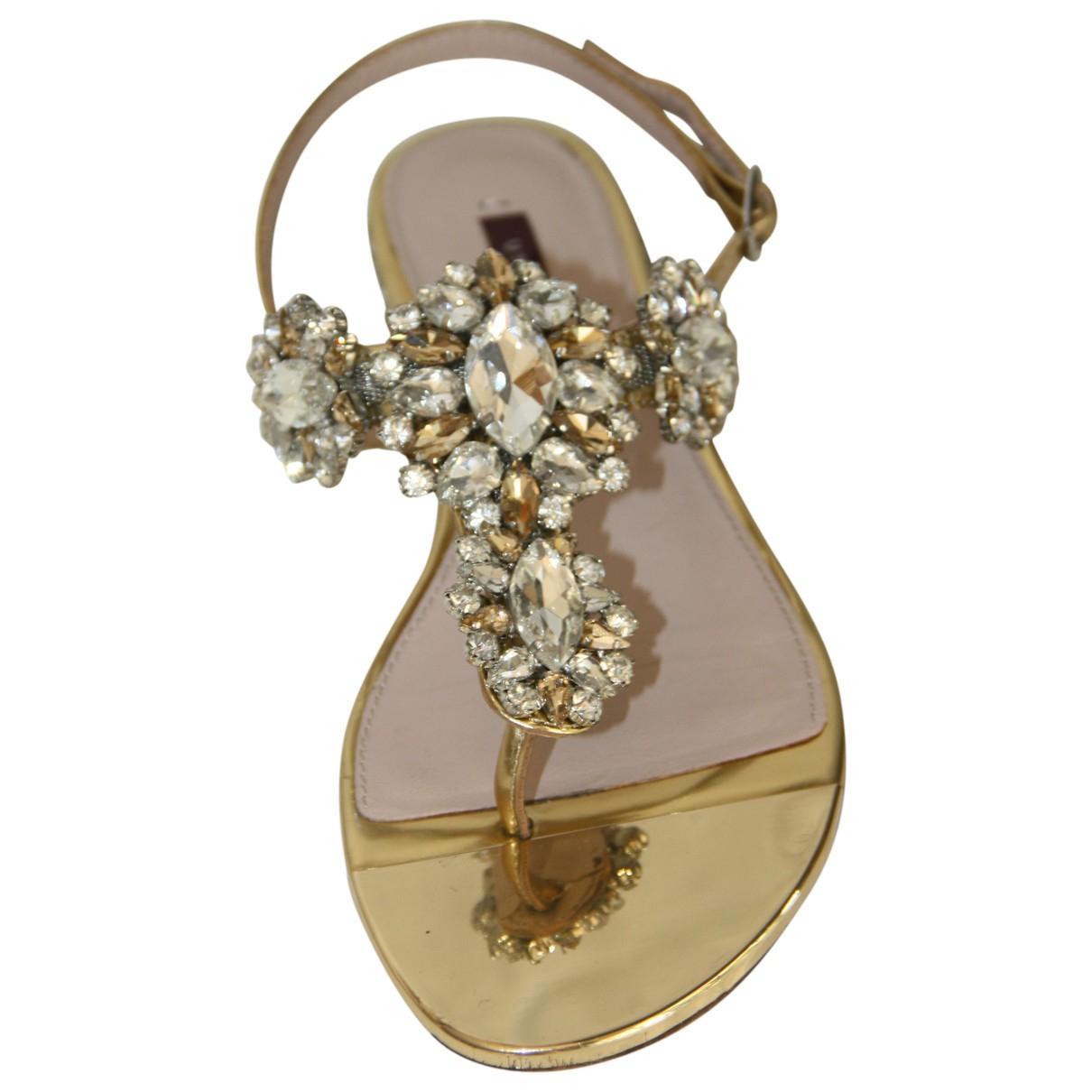 Uterque \N Sandalen in  Gold Lackleder