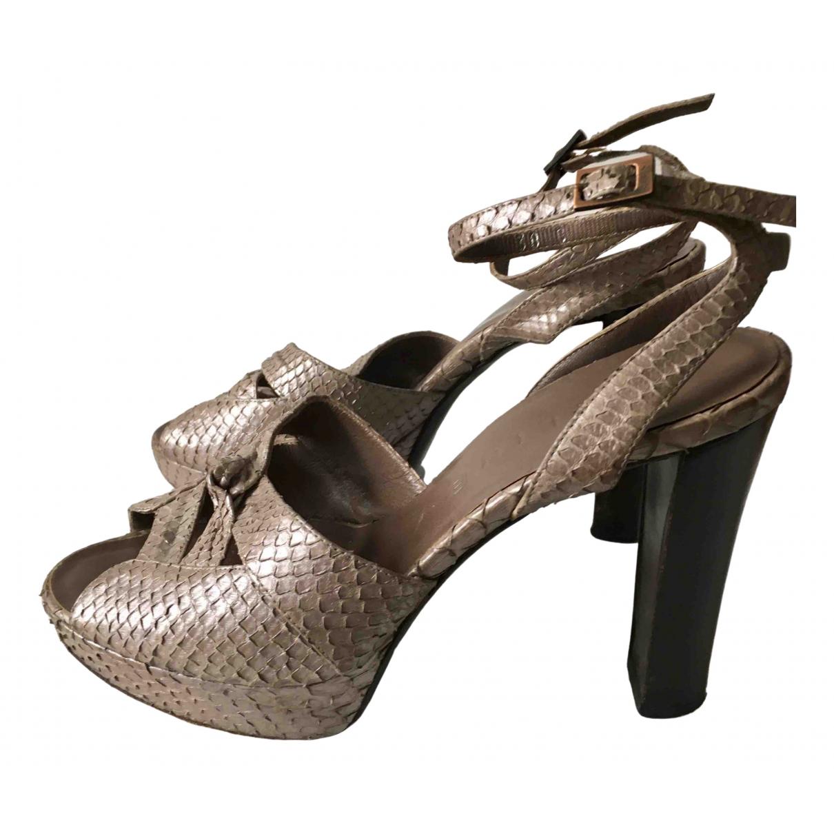 Celine \N Gold Water snake Heels for Women 38 EU