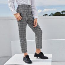 Pantalones de cuadros de doblez con boton delantero