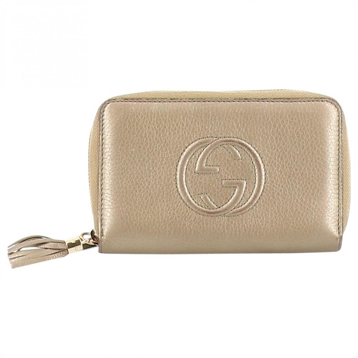 Gucci - Portefeuille   pour femme en cuir - dore