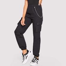 Pantalones farol con bolsillo lateral con cadena