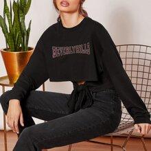 Pullover mit Strass, Buchstaben Grafik und Band am Saum
