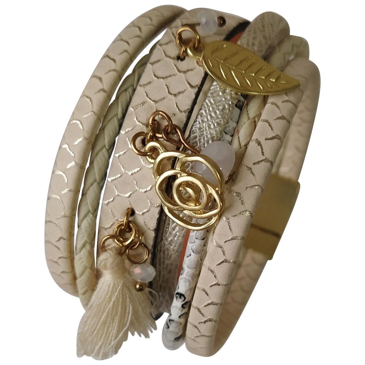 - Bracelet   pour femme en metal - beige