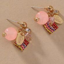 Ohrringe mit Perlen und Quasten