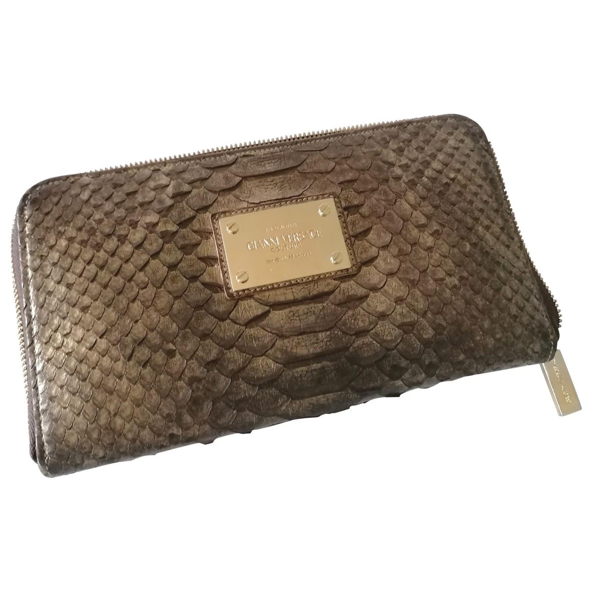 Versace \N Portemonnaie in  Braun Python