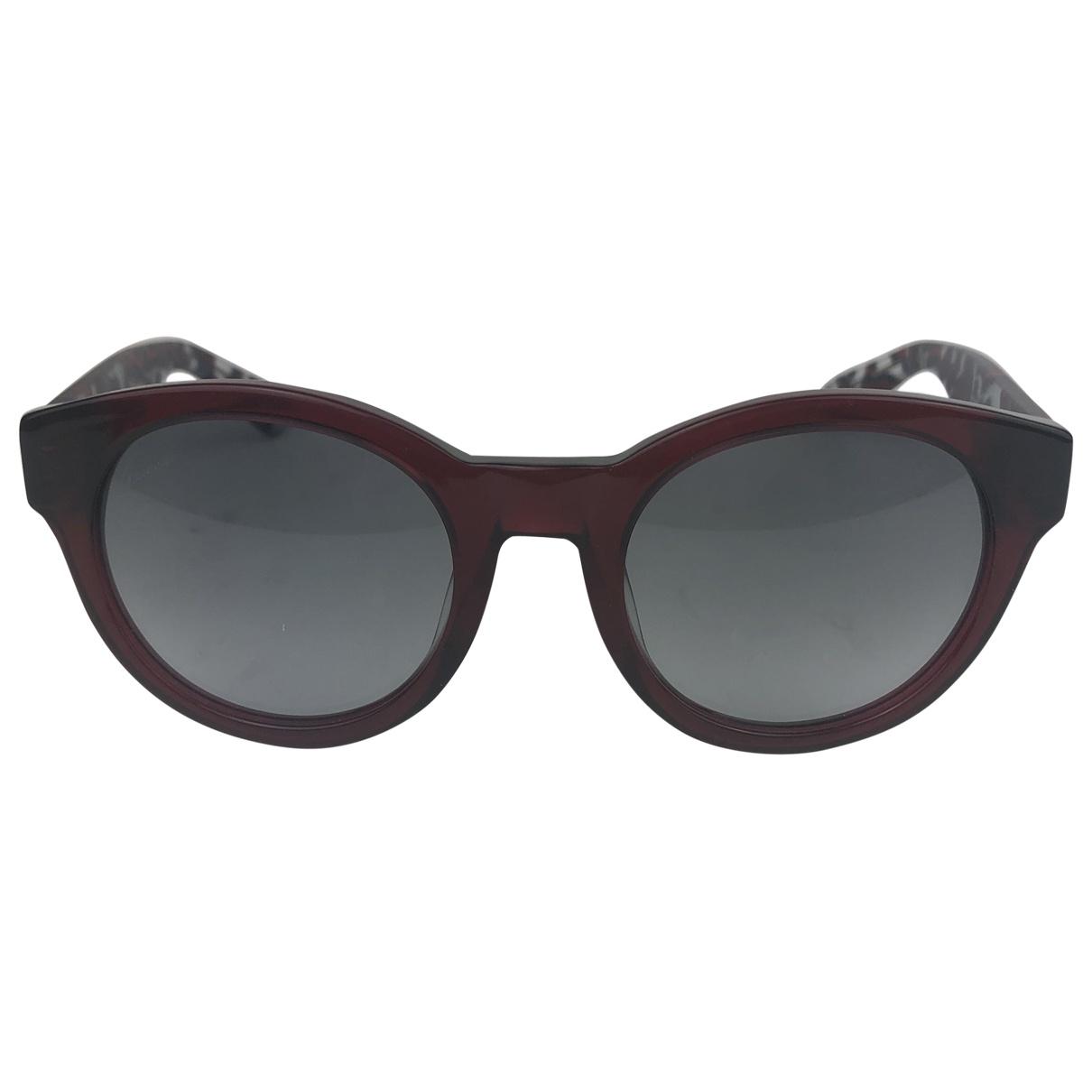 Gucci \N Sonnenbrillen in  Rot Kunststoff