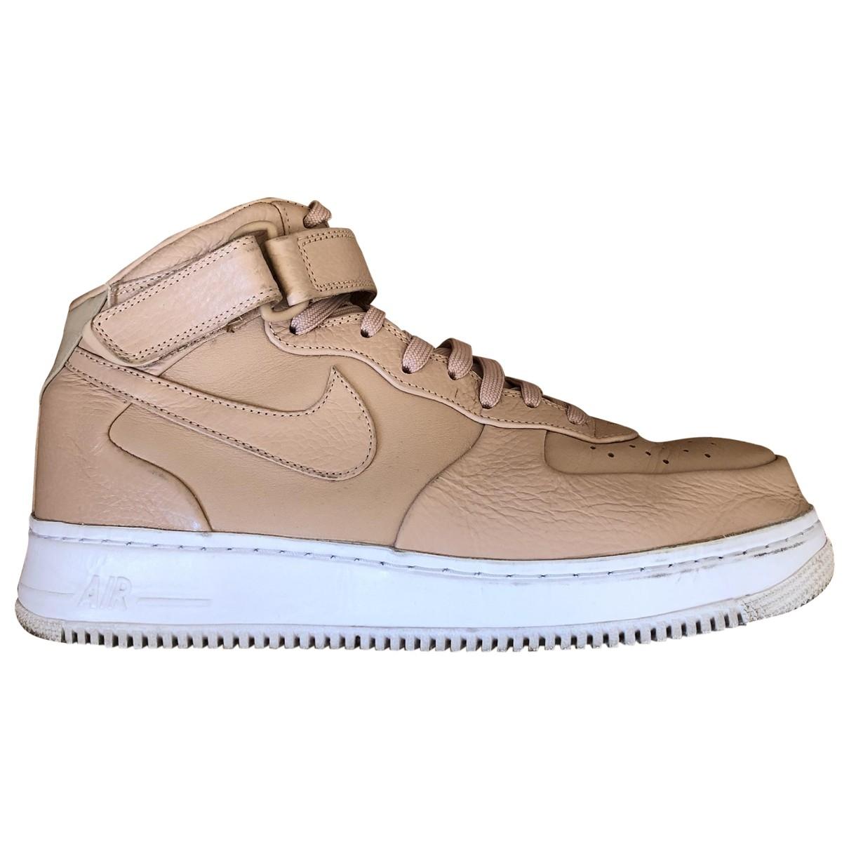Nike - Baskets Air Force 1 pour homme en cuir - beige