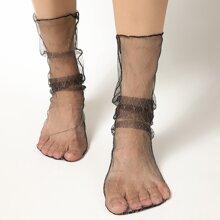 Socken mit geometrischem Muster und Spitze