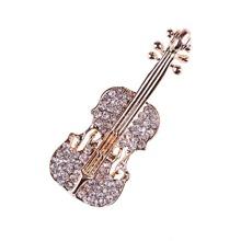 Broche en forma de violin con diamante de imitacion