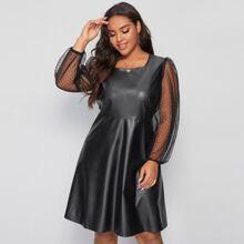 Kleid in Lederoptik mit Netzstoffaermeln