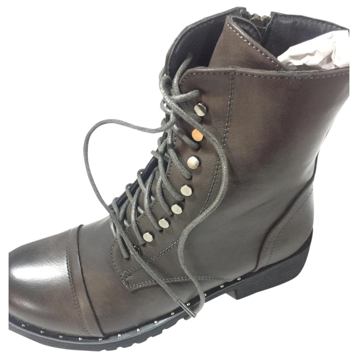 - Boots   pour femme
