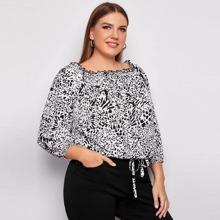 Bluse mit Muster und Rueschenbesatz