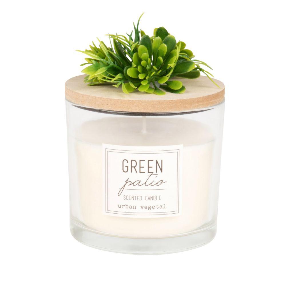Duftkerze im Glas mit kuenstlichen Pflanzen
