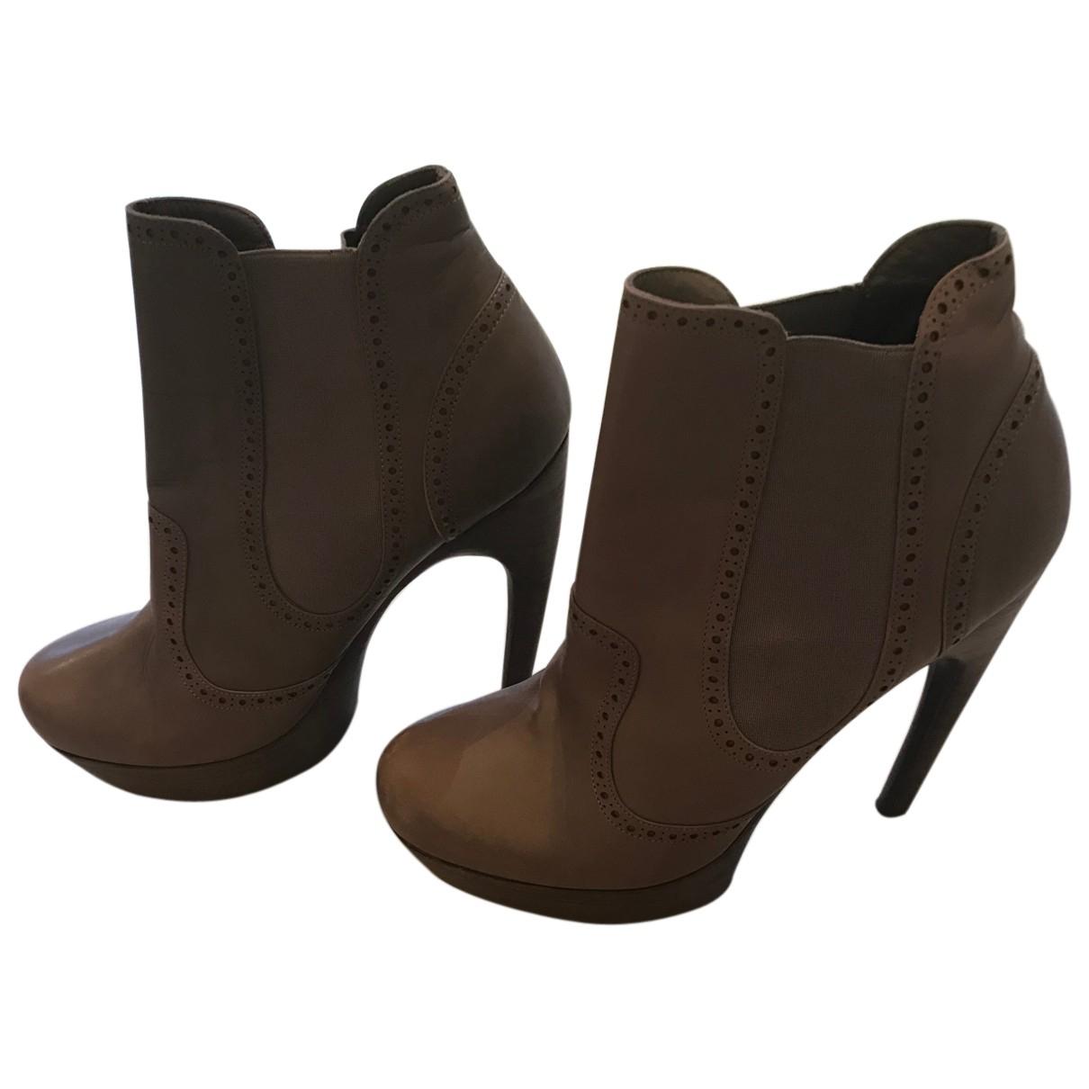 Alexander Mcqueen - Boots   pour femme en cuir - gris