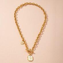 Halskette mit Figur und Geo Dekor