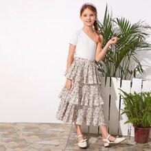 Conjunto de niñas top de un hombro con falda floral de margarita fruncido a capas