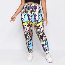 Pantalones deportivos con cordon delantero con estampado geometrico