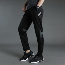 Sports Hose mit Kontrast Einsatz und Reissverschluss am Saum