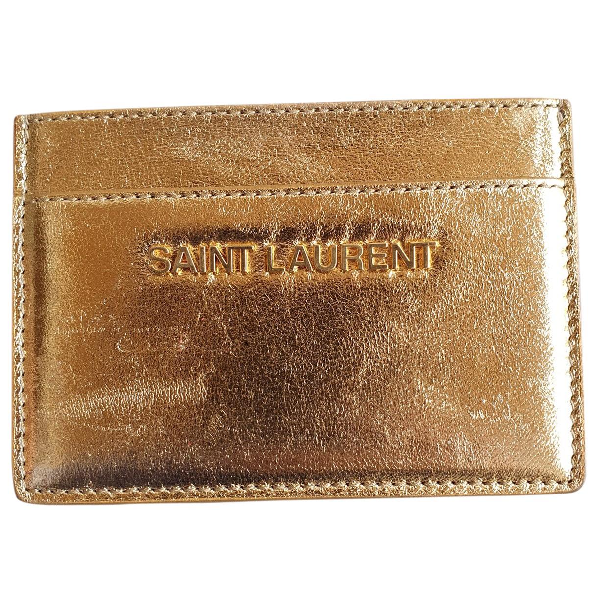 Saint Laurent - Portefeuille   pour femme en cuir - dore