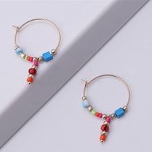 Ohrringe mit bunten Perlen