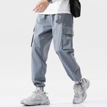 Cargo Hose mit seitlichen Taschen Klappen und Kordelzug
