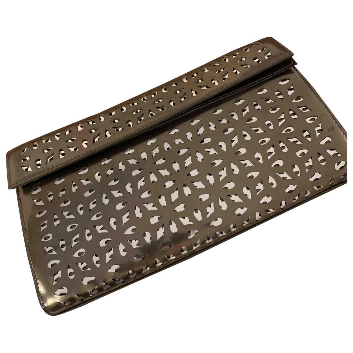 Alaïa \N Metallic Patent leather Clutch bag for Women \N