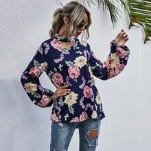 Bluse mit Blumen Muster und Peekaboo Ausschnitt
