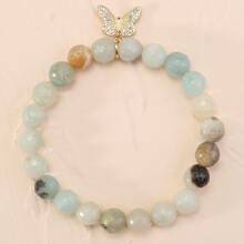 Armband mit Schmetterling Anhaenger und Perlen