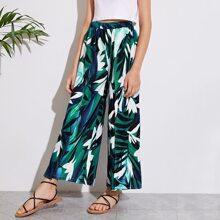 Maedchen Hose mit tropischem Muster und breitem Beinschnitt
