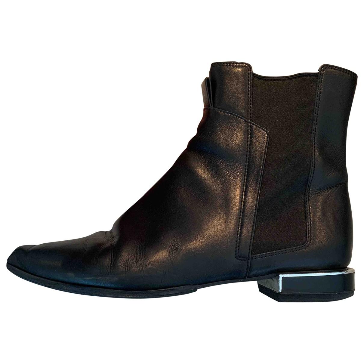 Kenzo \N Stiefeletten in  Schwarz Leder