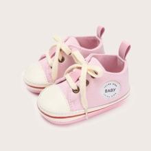 Zapatillas deportivas de bebe con cordon delantero